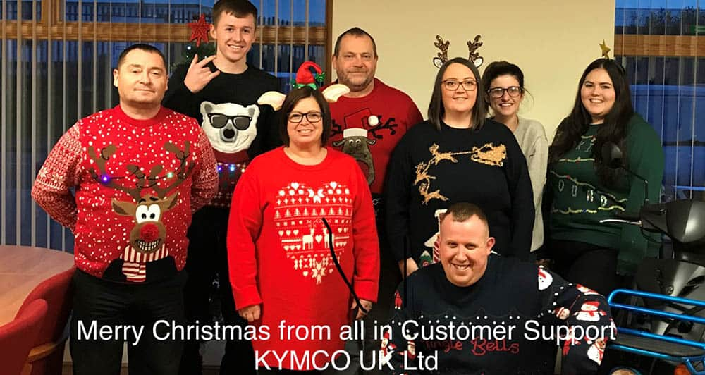 The team at Kymco Healthcare wearing their Xmas Jumpers for Save the Children
