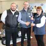 Julie Stokes, TGA Trade Coordinator/Area Sales Manager for Scotland & Ireland (right) presents David Delaney (left) and Tim Cronin (centre), MMS Medical Product Specialists, with a bottle of champagne in recognition of winning TGA Dealer of the Quarter.