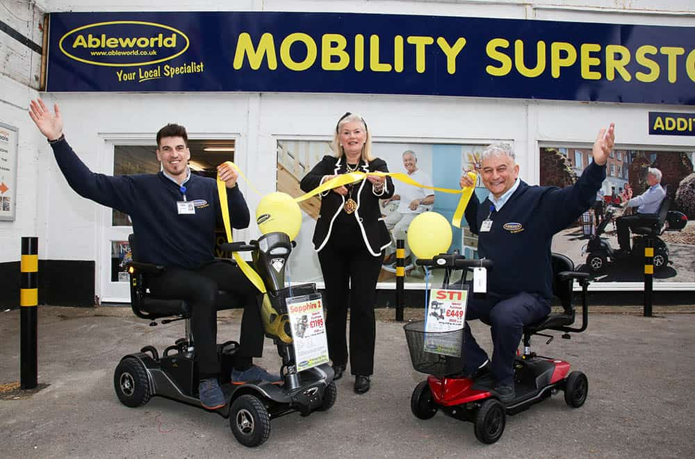 Mayor of Christchurch Town Cllr Lesley Dedman opens the new Ableworld branch in Christchurch with Branch Manager Eddie Raileanu and Franchise Director Chris Brown.
