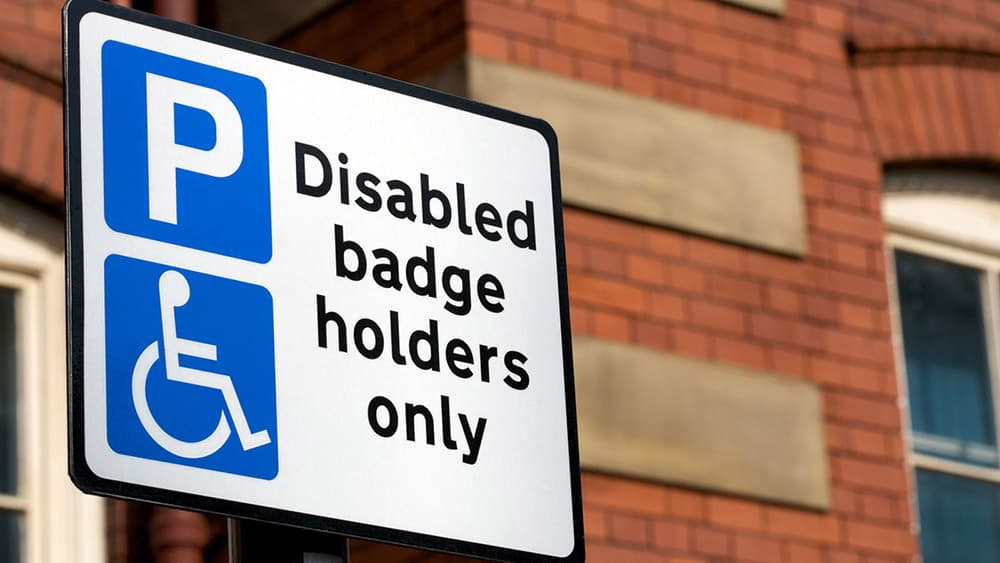 Blue Badge Only parking sign as hidden disabilities now part of scheme