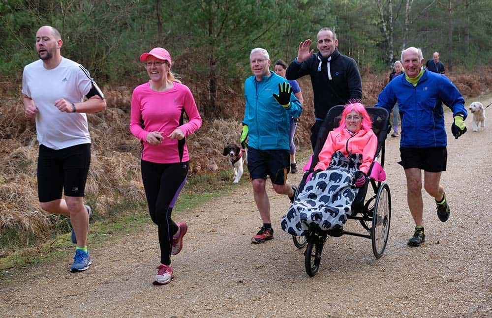 Glenys Waters taking part in a park run with her colourful wig