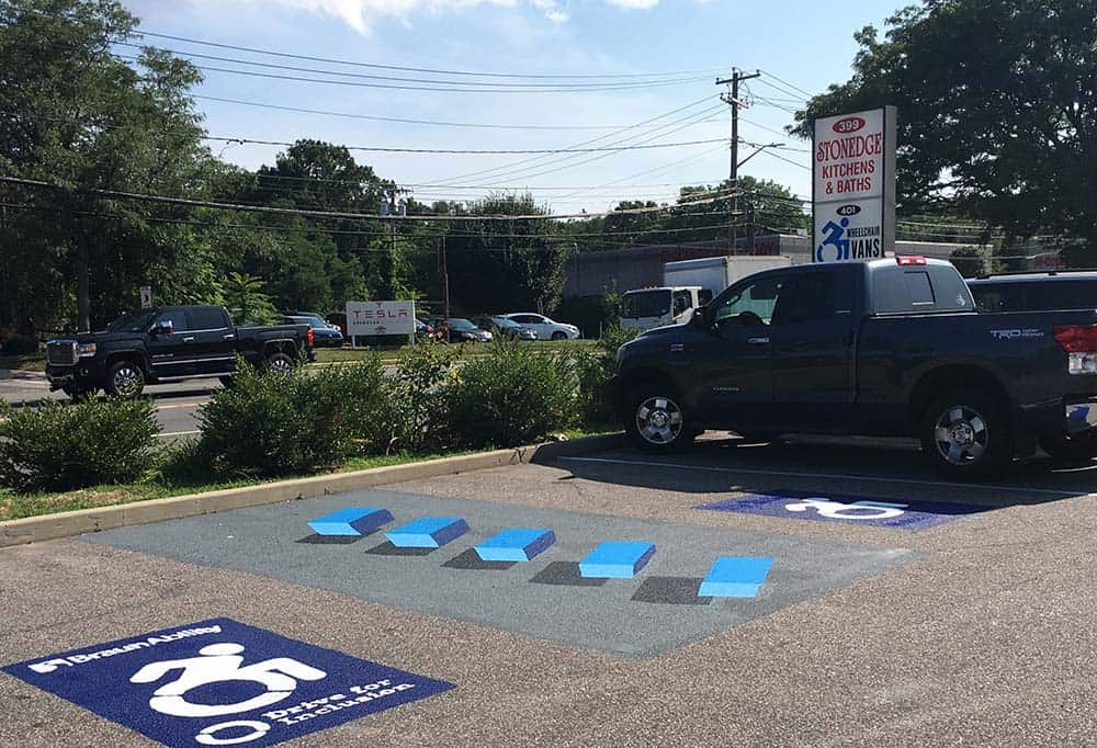 3D accessible parking aisle at Bussani Mobility combats illegal parking in spaces designated for people living with mobility challenges.
