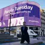 Mike Adams OBE at Picaddily Circus promoting Purple Tuesday