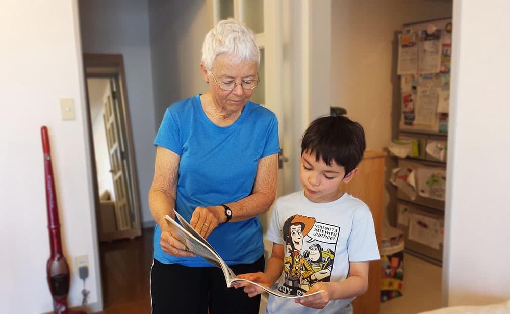grandmother reading to grandchildren