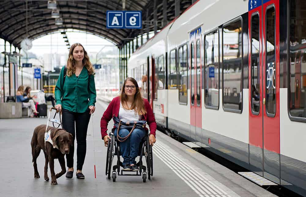 Wheelchair user at railway station image