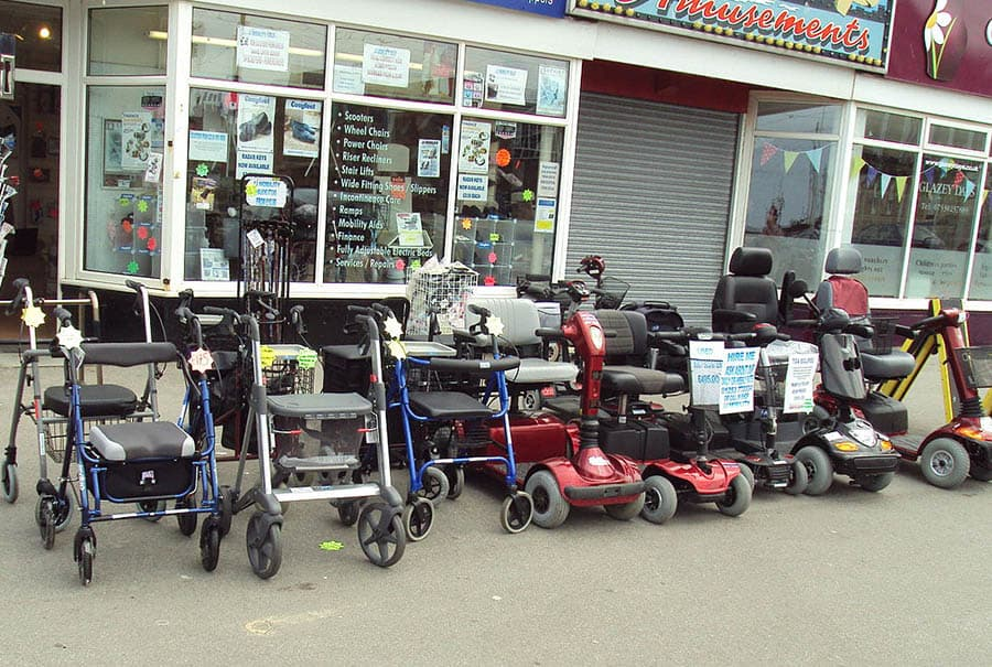 Walking frames mobility scooters outside store fleetwood