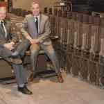 Brian and Alan Stannah with their stairlift ranges earlier in their careers