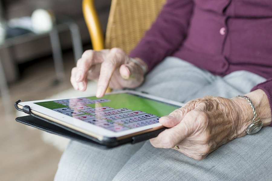 elderly woman using tech image