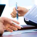 redundancies negotiation papers hands
