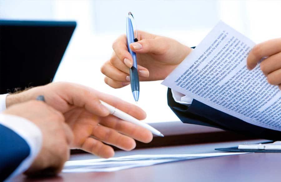redundancies negotiation papers hands