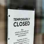 temporarily closed sign on shop door