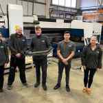 The Island Mobility team. From left: Emma Cowley, Andrew Ellis, Marcus Horton (holding one of the first prototype sections of unique stairlift rail, Alex Horton and Julie Horton