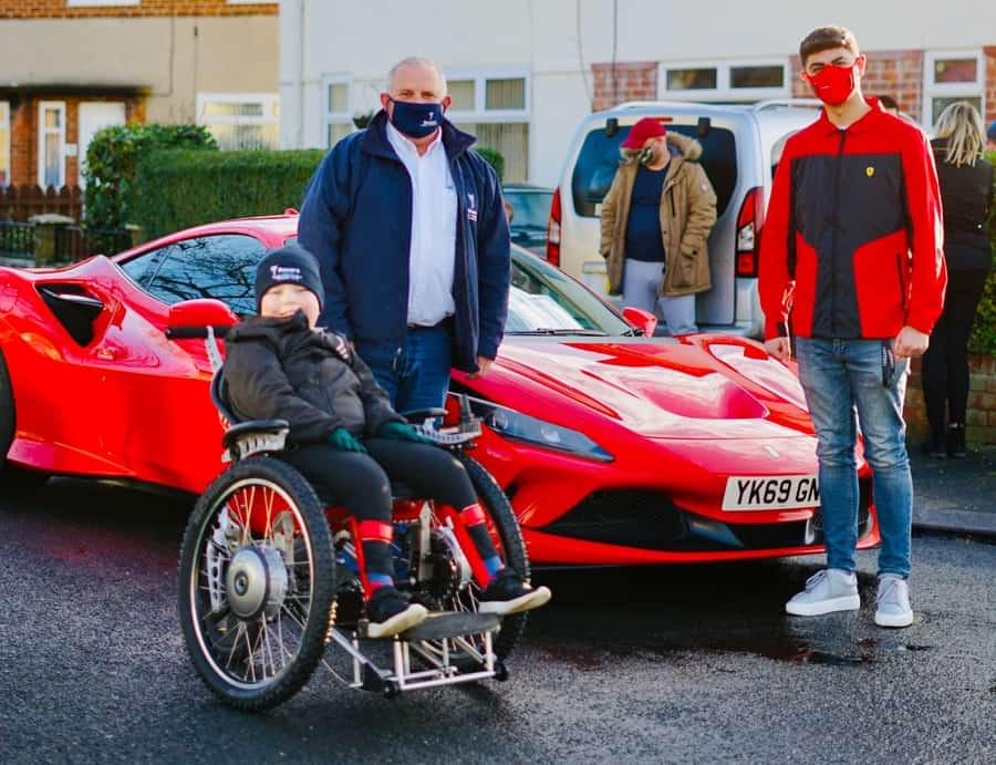 Recare gifts boy with F1-inspired powerchair