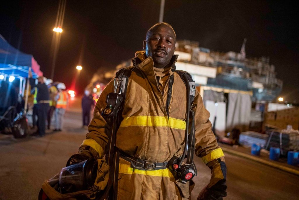 SAN DIEGO (July 14, 2020) Chief Machinist's Mate Sallyvidia Isiaho returns from combatting a fire aboard his ship, the amphibious assault ship USS Bonhomme Richard (LHD 6), at Naval Base San Diego. On the morning of July 12, a fire was called away aboard the ship while it was moored pier side at Naval Base San Diego. The fire continues to be fought into the following day. Bonhomme Richard is going through a maintenance availability, which began in 2018.