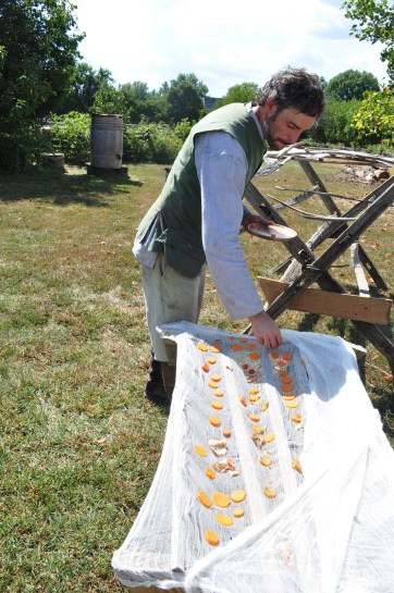 Colonial era interpreters show how they would dry foods in the sun.
