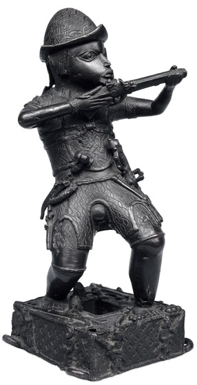 benin - Brass figure of a Portuguese soldier holding a musket, 17th century C.E.,