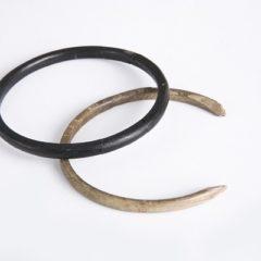 One black and one white bangle