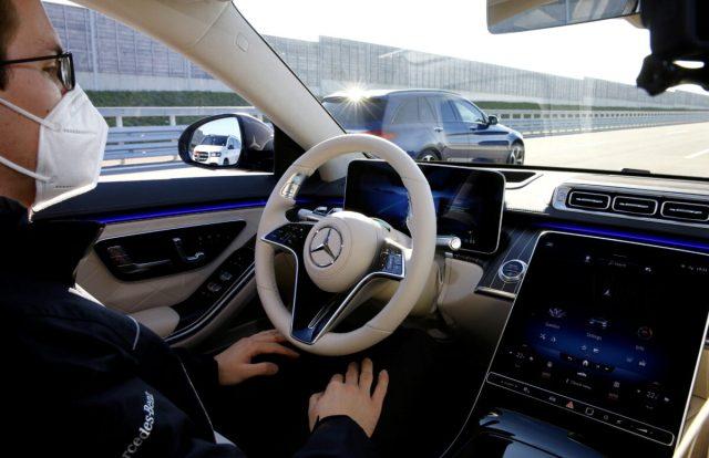 An employee demonstrates steering by autonomous driving system in a new Mercedes-Benz S-Class limousine near Immendingen
