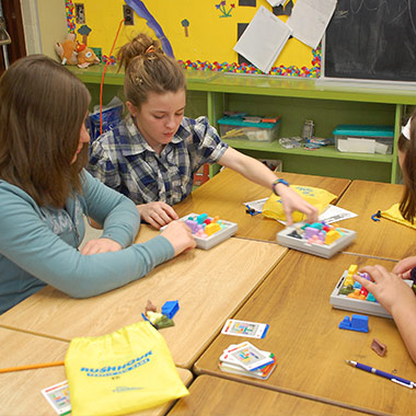 Students helping solve Rush Hour games together