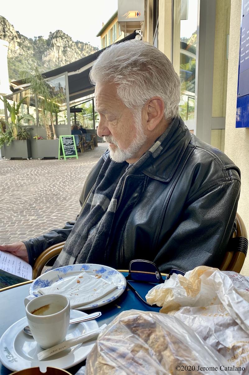Studying the menu at the Café le Beaulieu