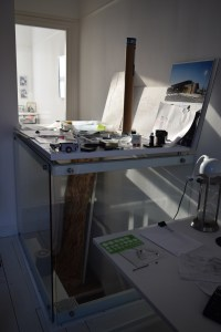 Architects studio Macclesfield. View of structural glass balastrade supporting counter with interior window beyond.