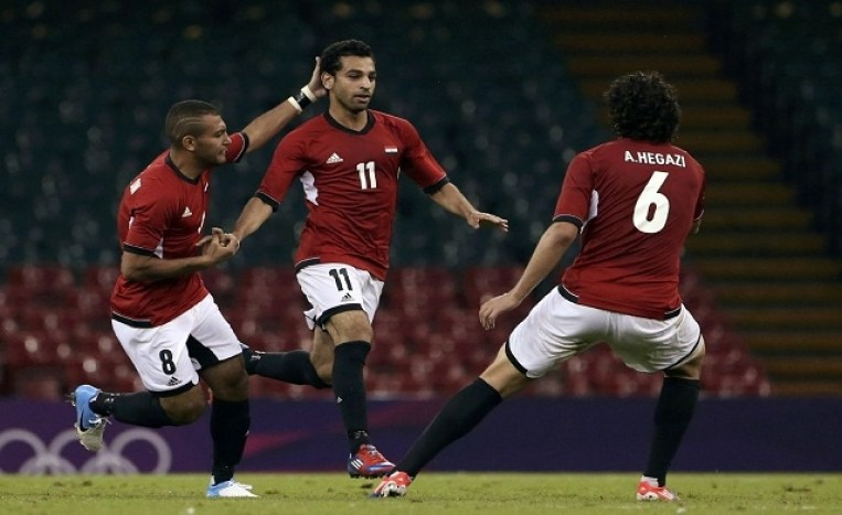 Egypt's Mohamed Salah (C) celebrates his goal against Brazil with teammates Shehab Ahmed and Ahmed Hegazi during their men's Group C football match against Brazil at the London 2012 Olympic Games. (Reuters)