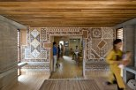 As seen in their offices in Bhuj, Hunnarshala has found ways to use thin pieces of waste wood to create structural elements. Photo by Andreas Deffner.