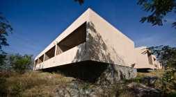 Rough basalt, undertone walls and cantilevered balconies