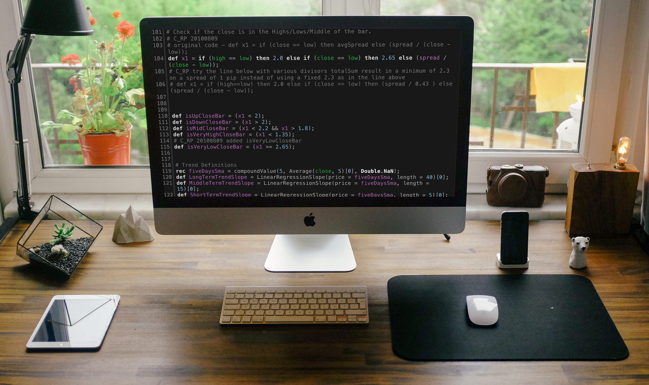 Photo of computer workstation with custom thinkScript programming and ThinkOrSwim development setup