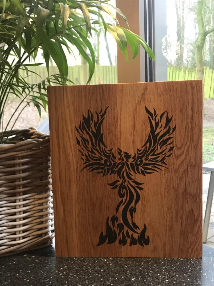 Phoenix tribal style burnt on wood using pyrography