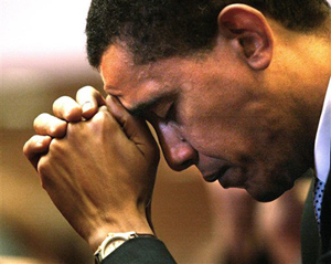 Barack Obama prays during services at Trinity United Church of Christ in Chicago in this 2004 photo. Obama resigned his 20-year membership in Trinity after controversial remarks by his longtime pastor the Rev. Jeremiah Wright threatened to derail his presidential candidacy.