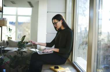 woman working from her living room