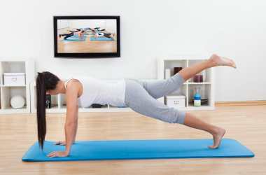 Woman practicing Yoga online