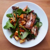 mixed greens salad with roasted veggies and whitefish