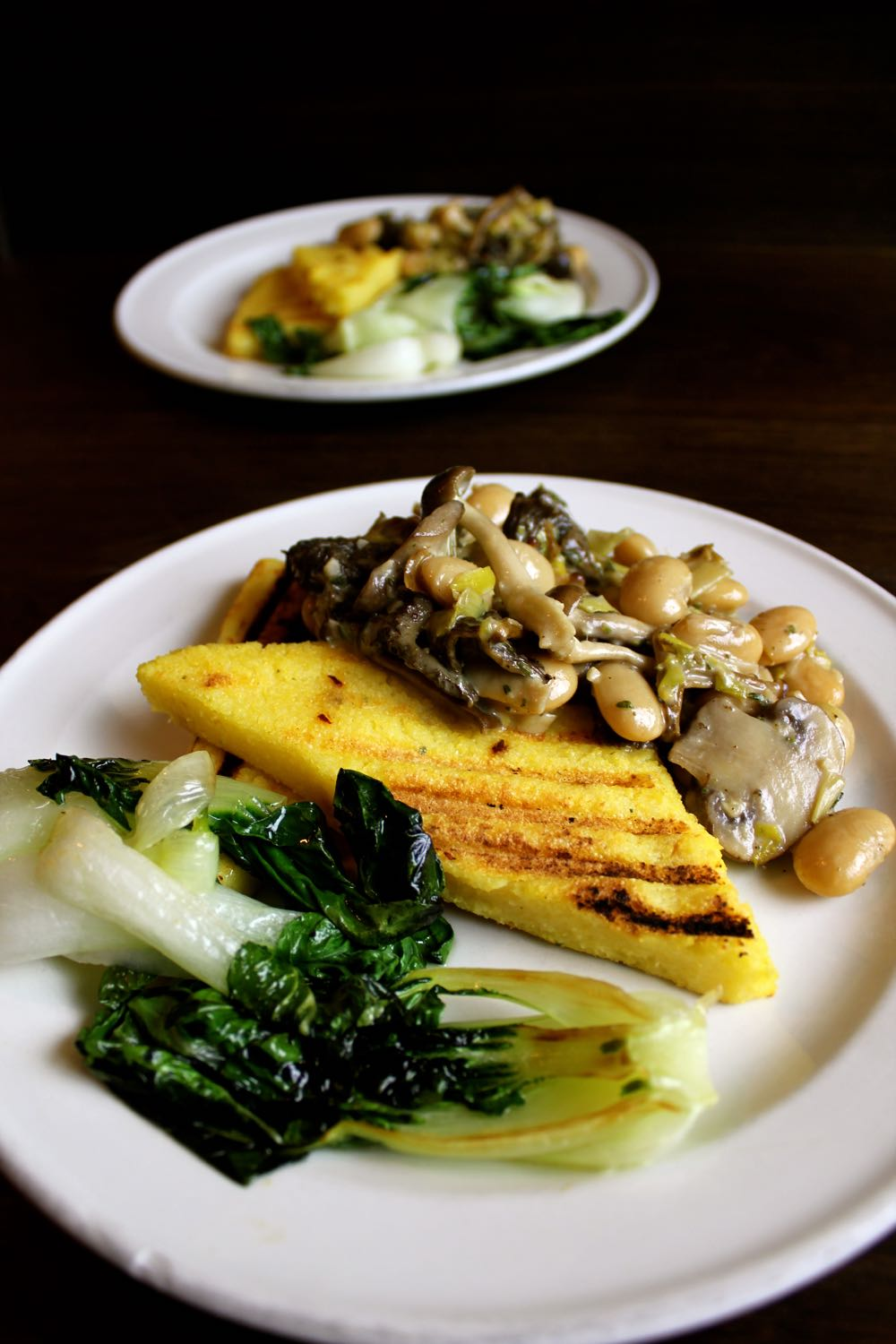 Polenta Bruschetta served with a mushroom and butter bean stew and pak choi