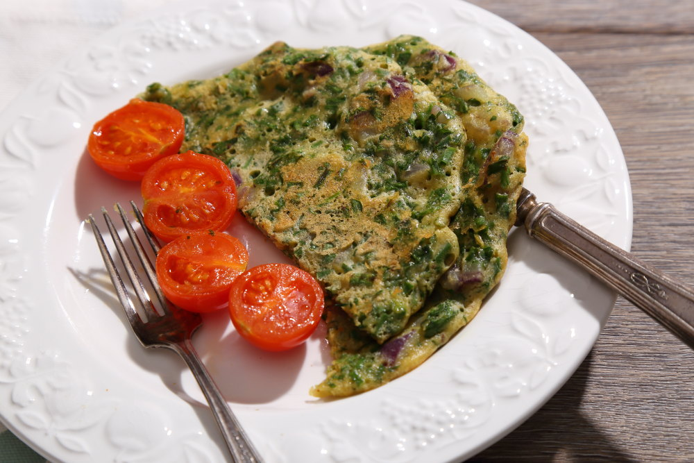 Fresh Herb Vegan Omelette served with gently fried tomatoes