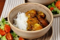 Roast Potato Curry Served with Basmati Rice in a rustic bowl