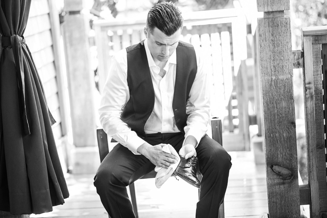 Groom polishing shoes