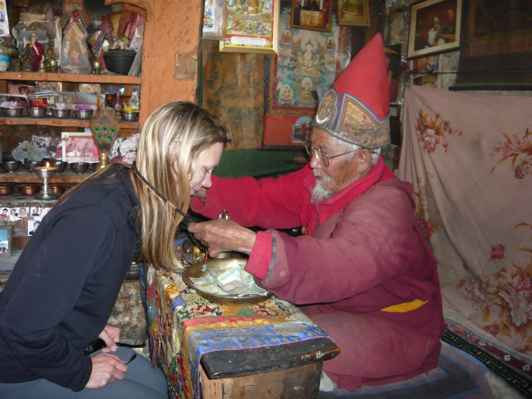 In Manang, Nepal being blessed by a 95-year-old monk. Circa 2010.