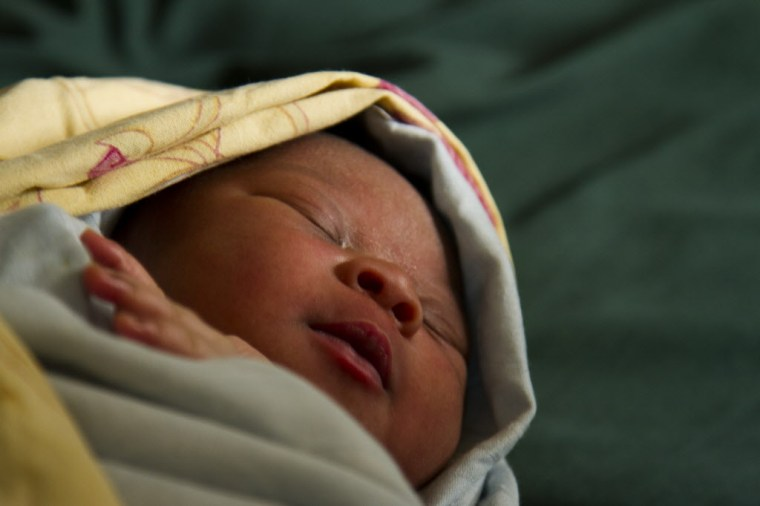 This is 18-year-old Maria's first child, a baby girl unnamed. The baby is approximately 1 hour old. Photo credit: Save the Children. Liberia.