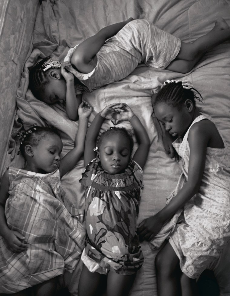 MAGGIE STEBER Nestled in their bed in Miami, Florida, four young sisters nap on a Sunday afternoon after attending church.