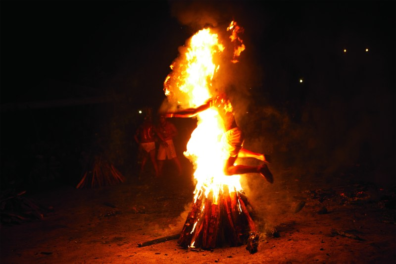 KITRA CAHANA After working himself into a trance, a man leaps through a flaming pyre.