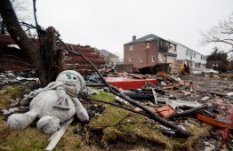 January 15th, 2013, Belle Harbor, New York: A snowman lays on the grass among the debris of burnt out homes in the aftermath of Superstorm Sandy. Photo credit: Save the Children