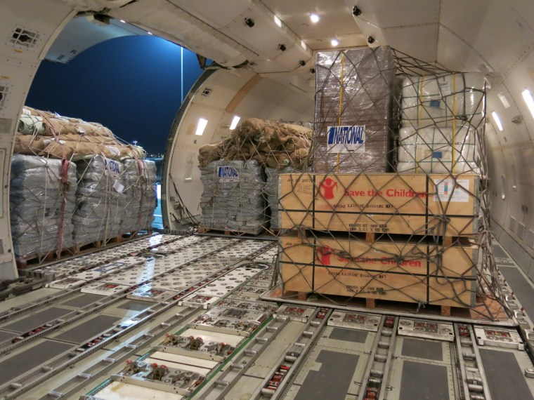 Inside the plane the aid gets unloaded. Photo credit: Save the Children