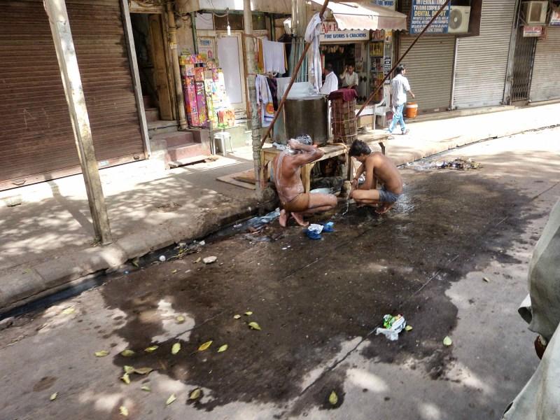 Men Washing in the Street Delhi