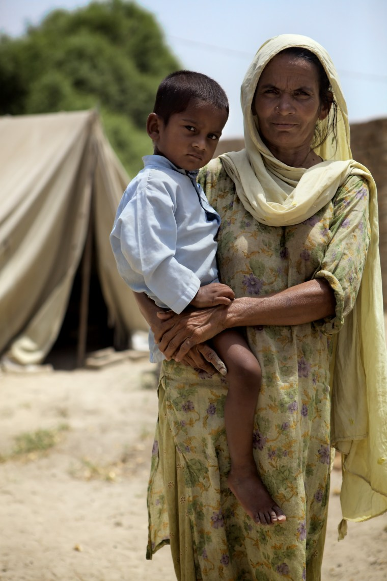 Jeeran Mei and her son Yousaf, two. Their home was destroyed in the 2010 floods in Pakistan. Photo credit: CJ Clarke/Save the Children