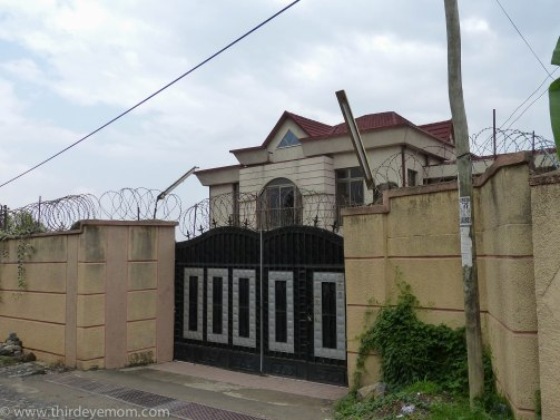 Most homes especially large ones are sealed away behind a gated wall.