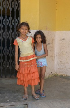 Two young girls pose for me during a visit to one of Delhi's many unauthorized slums.