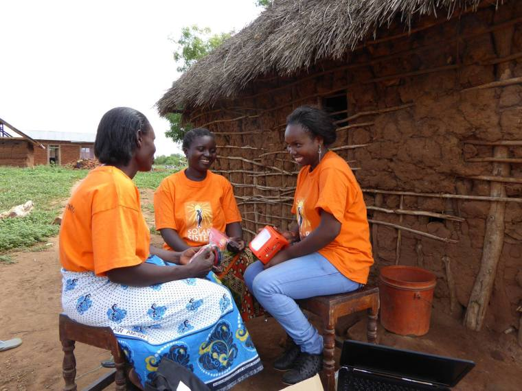A Solar Sister Entrepreneur demonstrates a light. Photo credit: Solar Sister
