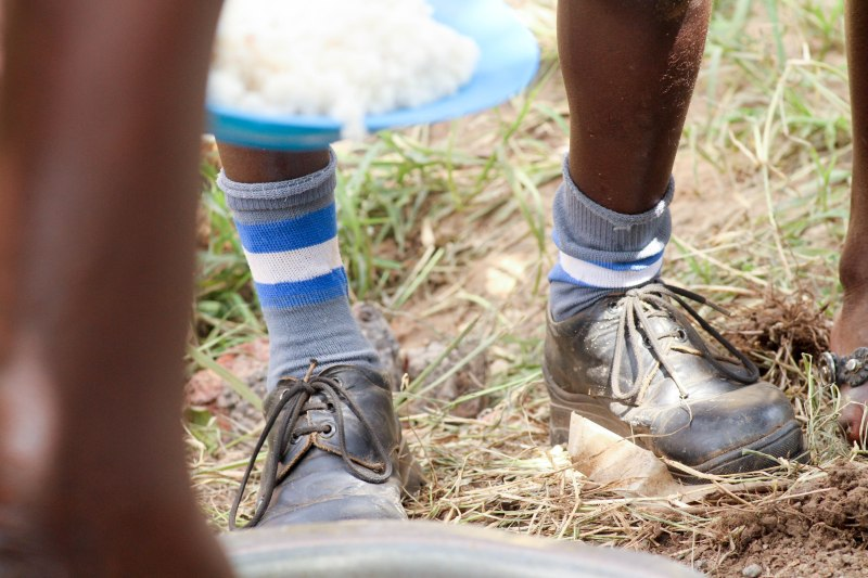 Odara David shows off his custom made leather shoes. These shoes were funded by b.a.r.e. soaps in 2015. Each child received their own locally made leather shoe. The shoemaker made over 150 pairs!
